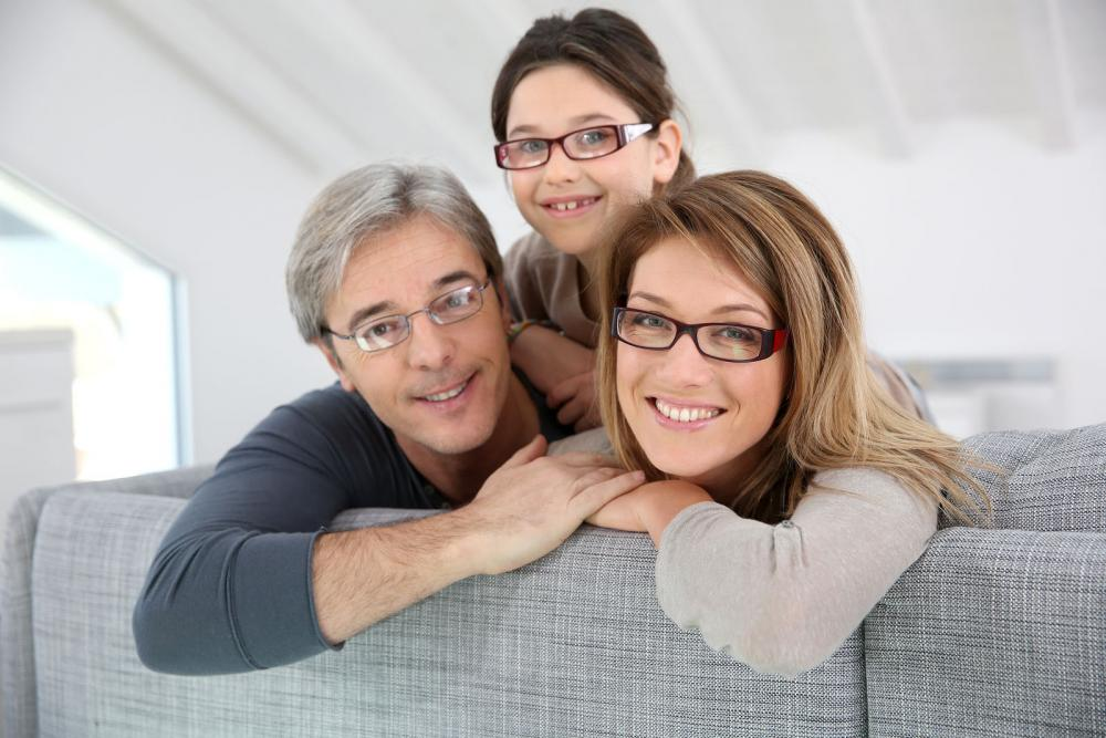 Family enjoying their new glasses from their local eye doctor in Utica